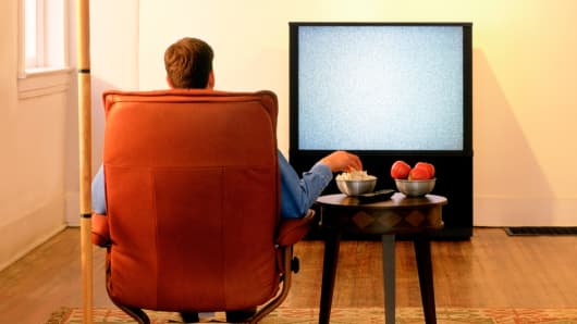 Man watching TV with empty screen