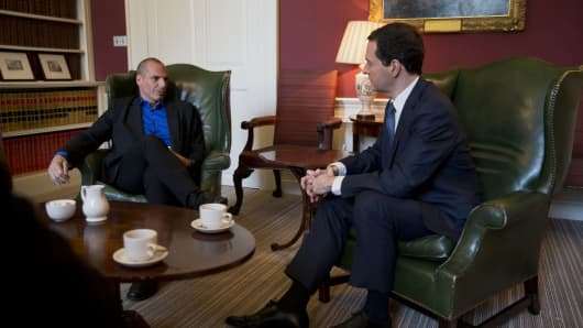 British Chancellor Of The Exchequer George Osborne (right), and Greece's new finance minister Yanis Varoufakis speak during their meeting at 11 Downing Street