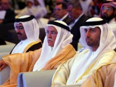 Qatar Oil Minister Mohammed bin Saleh Al-Sada (L), Saudi Oil Minister Ali al-Naimi, and United Arab Emirates Energy Minister Suhail bin Mohamed al-Mazroui (R) attend the opening session of the 10th Arab Energy Conference in Abu Dhabi, on December 21, 2014.