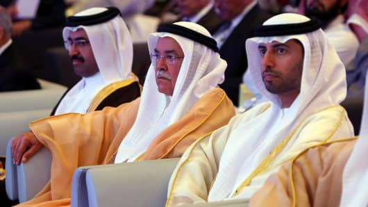 The oil ministers of Qatar, Saudi Arabia and the United Arab Emirates attend the opening session of the Arab Energy Conference in Abu Dhabi.