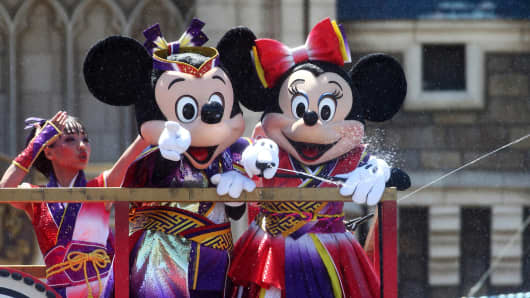 The Walt Disney Co. characters Mickey Mouse, front left, and Minnie Mouse perform in front of the Cinderella Castle during an event named 'Disney Natsu Matsuri' at Tokyo Disneyland, operated by Oriental Land Co., in Urayasu, Chiba Prefecture, Japan