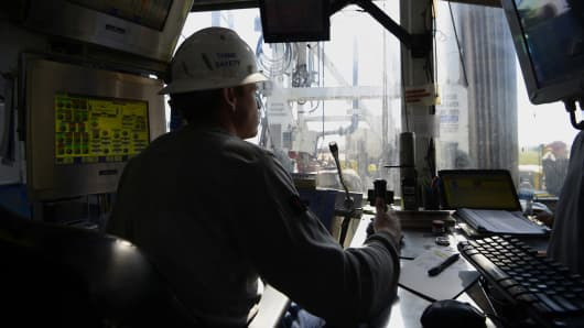 A contractor works in the control room at an Anadarko Petroleum Corp. oil rig site in Fort Lupton, Colorado.