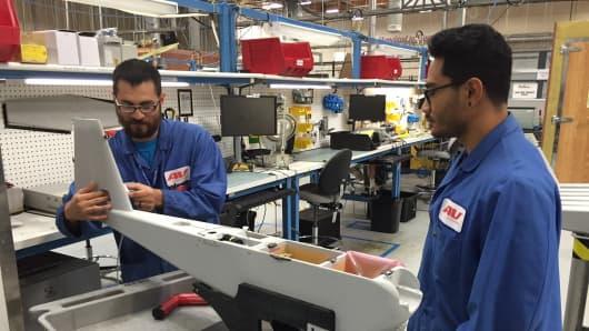 AeroVironment workers assemble a UAV.