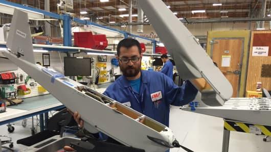 An AeroVironment worker assembles a UAV.