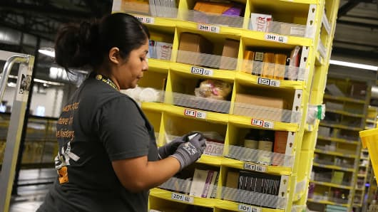 An Amazon.com worker picks orders at an Amazon fulfillment center in Tracy, California.