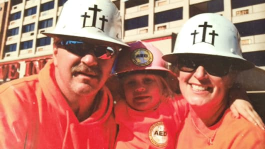 Eric and Lisa Kelly from Advanced Explosives Demolition with their daughter Eliya Joy.