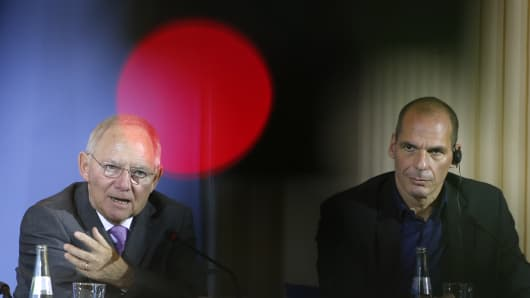 Greek Finance Minister Yanis Varoufakis and German Finance Minister Wolfgang Schaeuble (left) address a news conference following talks at the finance ministry in Berlin.