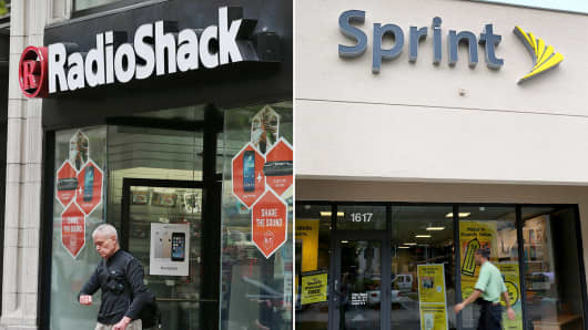 A customer leaves a RadioShack store in San Francisco and a Sprint store is shown in Fort Lauderdale, Fla.