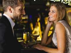 Couple having drinks at bar