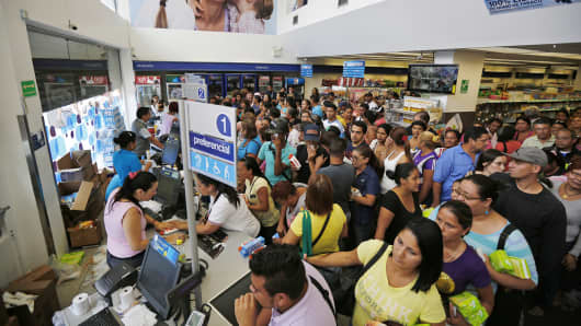People line up to buy hygiene products at a drugstore in Caracas, Venezuela, Feb. 3, 2015.
