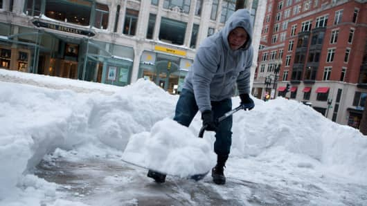 Workers continue snow removal efforts in the Back Bay neighborhood the day after Winter Storm Juno, on January 28, 2015 in Boston, Massachusetts.