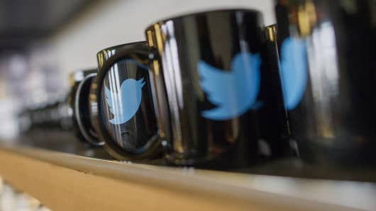 The Twitter logo is seen on coffee mugs inside the company's headquarters in San Francisco.