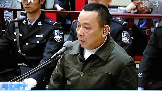 In this TV grab, Liu Han, center, former chairman of mining conglomerate Sichuan Hanlong Group, speaks during his verdict hearing at the Xianning Intermediate Peoples Court in Xianning city, central Chinas Hubei province, 9 February 2015.