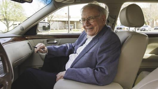 Warren Buffett's seated in Cadillac