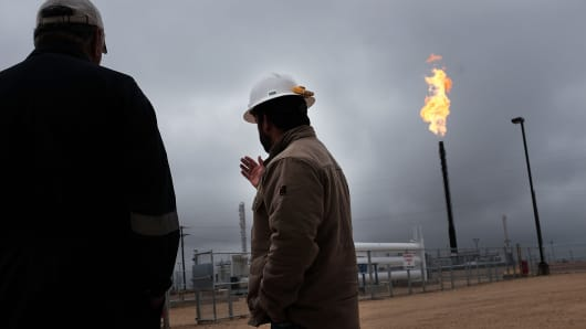Flared natural gas is burned at an Apache natural gas plant in the Permian Basin in Garden City, Texas.