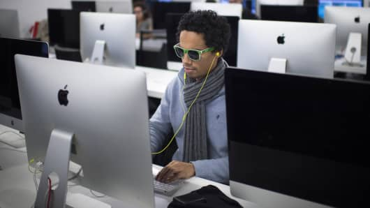A student works on an Apple computer at a computer programming school in Paris.