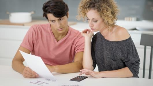 Couple bills financial stress
