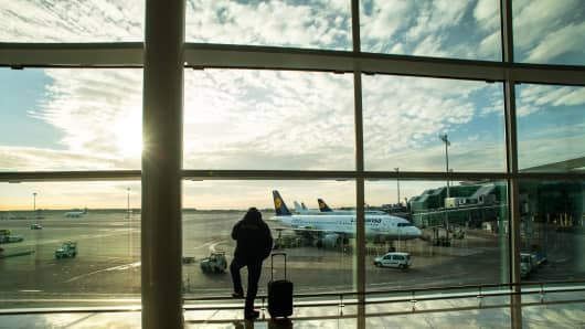 A passenger looks out of the window at Aena-operated Barcelona-El Prat International Airport