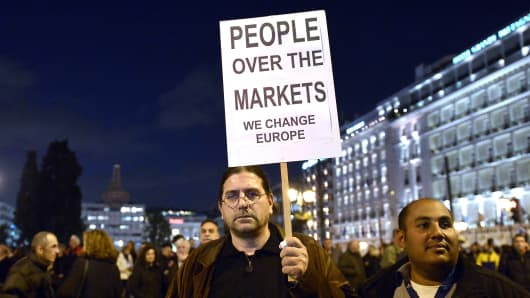 Crowds gather in front of the Greek parliament in Athens on Feb. 5, 2015, in support of the new anti-austerity government's efforts to renegotiate Greece's international loans.