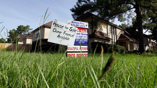 A file photo of a house for sale with an owner finance available sign in Houston.