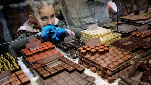 A girl looks over chocolates in a case at Jacques Torres Chocolate in the Soho neighborhood of New York.