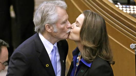 In this Jan. 12, 2015 file photo, Oregon Gov. John Kitzhaber kisses fiancee, Cylvia Hayes, after he is sworn in for an unprecedented fourth term as Governor in Salem, Ore.