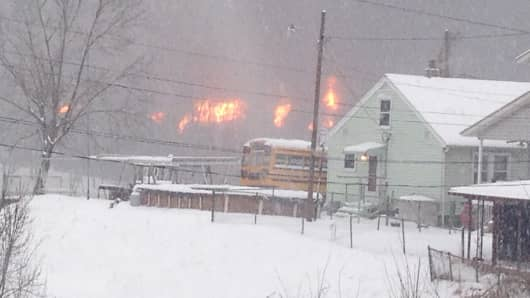 A fire burns Monday, Feb. 16, 2015, after a train derailment near Charleston, W.Va. Nearby residents were told to evacuate as state emergency response and environmental officials headed to the scene.