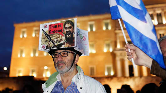 A protester takes part in an anti-austerity pro-government demonstration in Athens February 16, 2015.