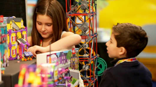 CNBC mini analysts Noa Suied, 7, and Vincent Scolaro, 6, test and review new toys at the K'NEX booth at Toy Fair on Monday, February 16, 2015.