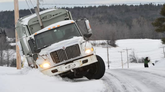 A garbage truck which slid off a road in Gorham, Maine.