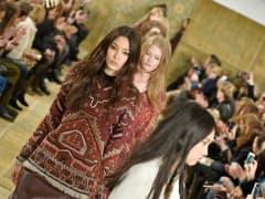 Models walk the runway at the Tory Burch Fall 2015 fashion show during New York Fashion Week