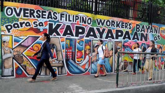 A mural honoring overseas Filipino workers in Manila.