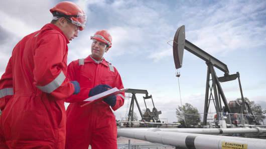 Workers near oil pumpjack