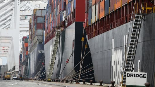 Container ships sit docked in a berth at the Port of Oakland on Feb. 17, 2015.