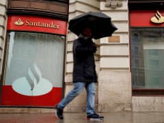 Man walking past Santander branch