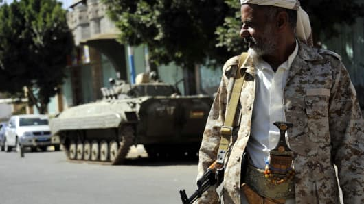 Houthi rebels take security measures with tanks around the parliament in Sanaa, Yemen, in February 2015.