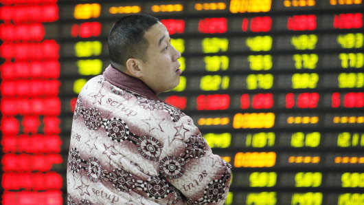 Share holders observe the stock market at a stock exchange corporation in Nantong, Jiangsu province of China.