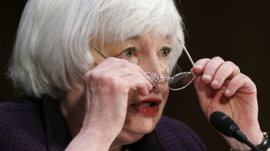 "Federal Reserve Chair Janet Yellen adjusts her glasses as she testifies at a Senate Banking, Housing and Urban Affairs Committee hearing on ""Semiannual Monetary Policy Report to Congress"" on Capitol Hill in Washington, February 24, 2015."