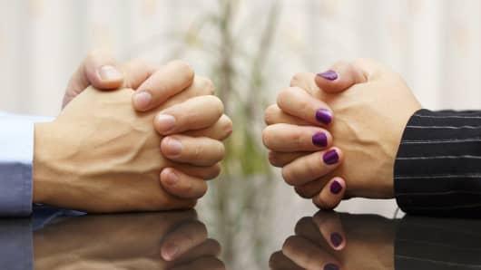 Man woman hands folded