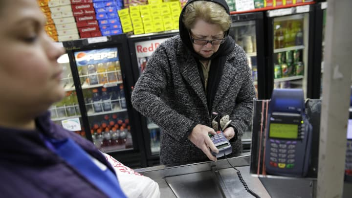 A woman pays for her groceries using a food stamp program at a supermarket in West New York, N.J., Monday, Jan. 12, 2015.