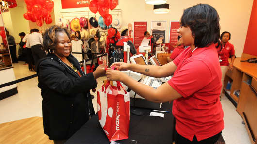 A customer shops at the opening of TJ Maxx's 1000th store in Washington, DC.