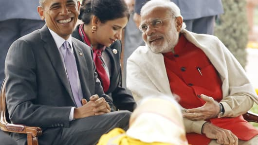 U.S. President Barack Obama laughs as he talks with India's Prime Minister Narendra Modi at the Rashtrapati Bhavan presidential palace in New Delhi, Jan. 26, 2015.
