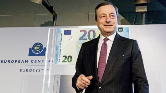 Mario Draghi, president of the European Central Bank (ECB), looks on as he unveils a new twenty-euro banknote at the ECB headquarters in Frankfurt, Germany, Feb. 24, 2015.