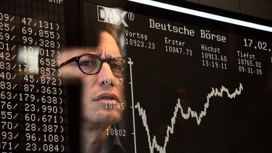 A trader works at the stock exchange in Frankfurt, Germany, Feb. 17, 2015.