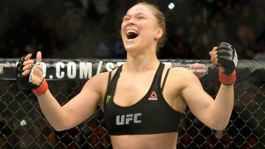 Ronda Rousey celebrates after defeating Cat Zingano during their women's bantamweight title bout at UFC 184 at Staples Center.