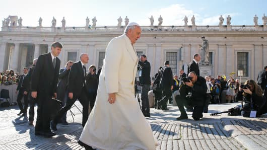 Pope Francis arrives to lead the weekly audience in Saint Peter's Square at the Vatican, February 18, 2015.