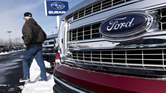 A man browses 2014 Ford Motor Co. F-150 trucks displayed for sale at Uftring Ford car dealership in East Peoria, Illinois, U.S., on Monday, March 2, 2015.