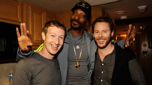 Facebook founder Mark Zuckerberg, rapper Snoop Dogg, and entrepreneur Sean Parker pose backstage at Sean Parker's Celebration of Music on September 22, 2011 in San Francisco, California.