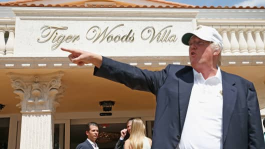 Donald Trump stands in front of the Tiger Woods Villa prior to the start of the World Golf Championships-Cadillac Championship at Trump National Doral on March 5, 2014 in Doral, Florida.