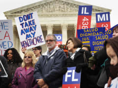Supporters of the Affordable Care Act gather in front of the U.S Supreme Court during a rally March 4, 2015 in Washington.